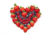 Red fruit heart on white background — Stok fotoğraf