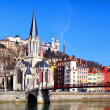 Lyon cityscape from Saone river with footbridge — Stock Photo