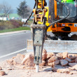 Jackhammer working on the road — Stock Photo