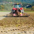 Ploughing heavy tractor during cultivation — Stock Photo #27818853