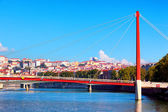 View of Lyon with Saone river and famous red footbridge — Stock Photo