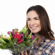 Smiling woman with bouquet — Stock Photo #28475697