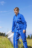 Woman farmer walking — Stock Photo