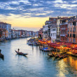 Gondolas at sunset in Venice — Stock Photo #30379935