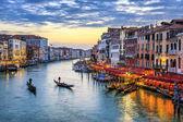 Gondolas at sunset in Venice — Stock Photo