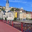 Stock Photo: View of Lyon city and red footbridge