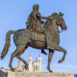 Statue of Louis XIV and Fourviere basilica — Stock Photo
