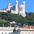 Statue of Louis XIV and basilica — Stock Photo #30900533