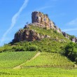 Solutre Rock with vineyards in Burgundy — Stock Photo #30908965