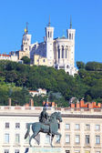Statue of Louis XIV and basilica — Stock Photo
