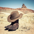 Boots and hat at Mexican Hat — Stock Photo