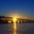 Colorful sunset with broken bridge — Stock Photo #39923551