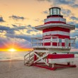 Stock Photo: Sunrise with famous lifeguard tower