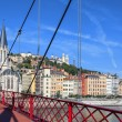 Lyon city with red footbridge on Saone river — Stock Photo