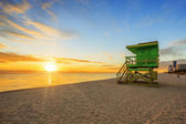 Miami South Beach sunrise with lifeguard tower — Stock Photo