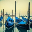 Gondolas floating in the Grand Canal at sunset — Stock Photo #47795885