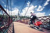 Bike on red footbridge — Stock Photo