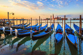 Venice with famous gondolas at sunrise — Stock Photo