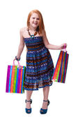 Child shopping. Happy fashion little redhead girl with shopping — Stock Photo