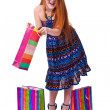 Happy fashion little redhead girl with shopping bags. — Stock Photo #20380823