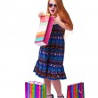 Happy fashion little redhead girl with shopping bags. — Stock Photo #20380827