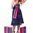 Happy fashion little redhead girl with shopping bags. — Stock Photo #20380837