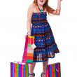 Happy fashion little redhead girl with shopping bags. — Stock Photo #20380845