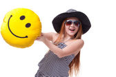 Beautiful young elementary age school girl with big yellow smile — Stock Photo