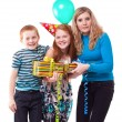 Happy Family celebrates birthday - Stock Photo