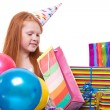 Happy party redhead girl with balloons and gift box — Stock Photo #21000653