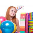 Happy party redhead girl with balloons and gift box — Stock Photo #21000659