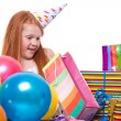 Happy party redhead girl with balloons and gift box — Stock Photo #21000663