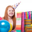 Happy party redhead  girl with balloons and gift box  — Stock Photo