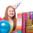 Happy party redhead girl with balloons and gift box — Stock Photo #21000667