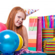 Happy party redhead girl with balloons and gift box — Stock Photo #21000679