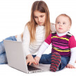 Brother and sister using laptop computer — Stock Photo