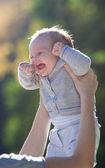 Happy baby in mother hands — Stock Photo