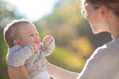 Mother and baby in park portrait — Foto Stock