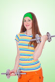 Portrait of young fitness woman on green background — Photo