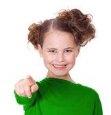Small beautiful girl shows a finger of a hand in a direction of — Stock Photo