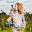 Portrait of pregnant woman on the  field — Stock Photo