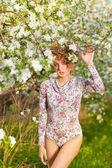 Beautiful blonde in a spring garden — Stock Photo