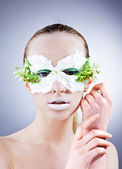 Beautiful woman portrait in mask from the flowers — Stock Photo