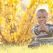 Cute child in sun back light — Stock Photo #25126925