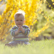 Cute child in sun back light — Foto de Stock