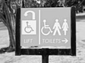 Lift and toilets sign — Stock Photo