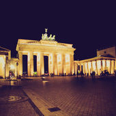 Retro look Brandenburger Tor Berlin at night — Stock Photo