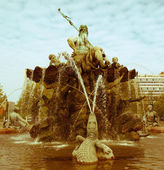 Retro looking Neptunbrunnen — Stock Photo