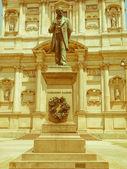 Retro looking Manzoni statue, Milan — Stock Photo