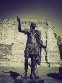 Vintage sepia Emperor Trajan Statue — Stock Photo